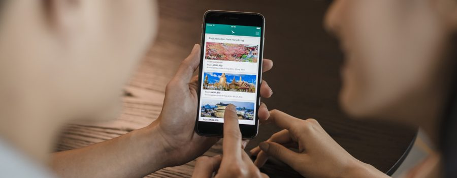 People using the Cathay Pacific mobile app